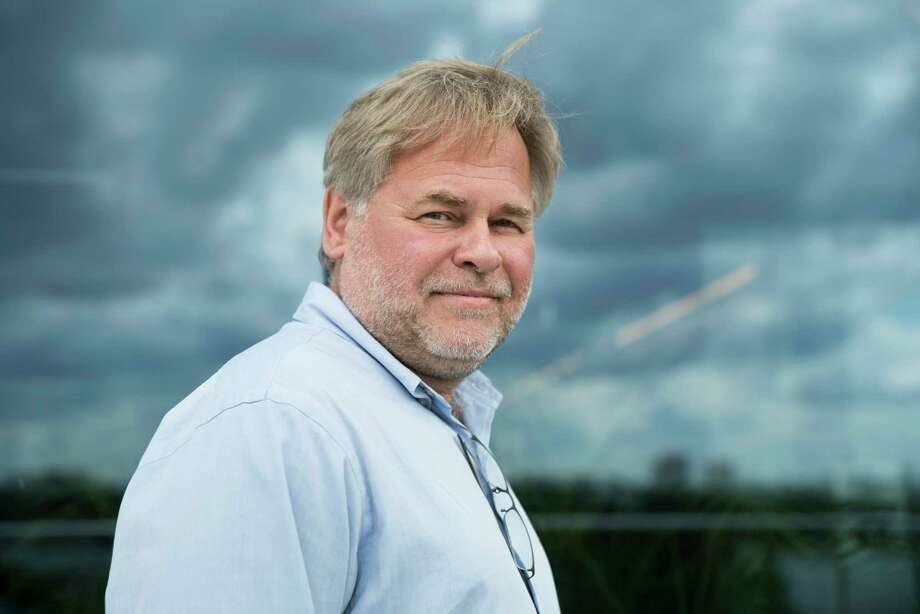 FILE - In this July 1, 2017, file photo, Eugene Kaspersky, Russian antivirus programs developer and chief executive of Russia's Kaspersky Lab, poses for a photo on a balcony at his company's headquarters in Moscow, Russia. The founder of Russian anti-virus firm Kaspersky tells The Associated Press his company did upload classified U.S. documents a couple of years ago, only to delete them immediately after realizing what had happened. Kaspersky's acknowledgement is the first on-the-record confirmation of an incident described earlier this month in three U.S. newspapers.(AP Photo/Pavel Golovkin, File) Photo: Pavel Golovkin, STF / Copyright 2017 The Associated Press. All rights reserved.