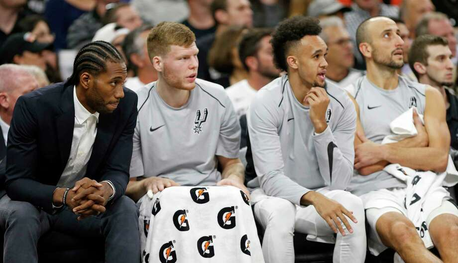 San Antonio SpursÕ Kawhi Leonard (from left), Davis Bertans, Derrick White, and Manu Ginobili watch second half action against the Toronto Raptors from the bench Monday Oct. 23, 2017 at the AT&T Center. The Spurs won 101-97. Photo: Edward A. Ornelas, San Antonio Express-News / © 2017 San Antonio Express-News