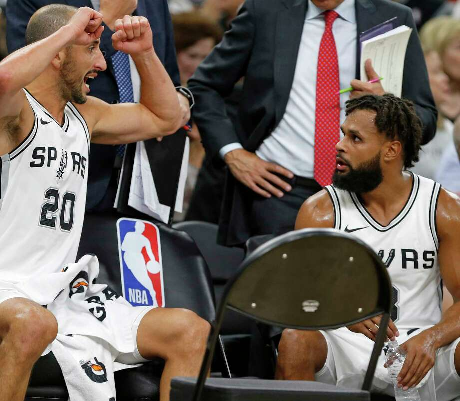 San Antonio SpursÕ Manu Ginobili talks with Patty Mills on the bench during a second half timeout against the Toronto Raptors Monday Oct. 23, 2017 at the AT&T Center. The Spurs won 101-97. Photo: Edward A. Ornelas, San Antonio Express-News / © 2017 San Antonio Express-News