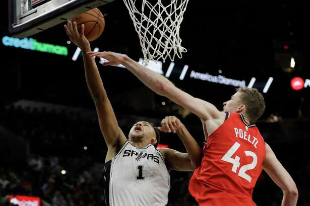 San Antonio Spurs guard Kyle Anderson (1) drives to the basket against Toronto Raptors center Jakob Poeltl (42) during the second half of an NBA basketball game, Monday, Oct. 23, 2017, in San Antonio. San Antonio won 101-97. (AP Photo/Eric Gay)