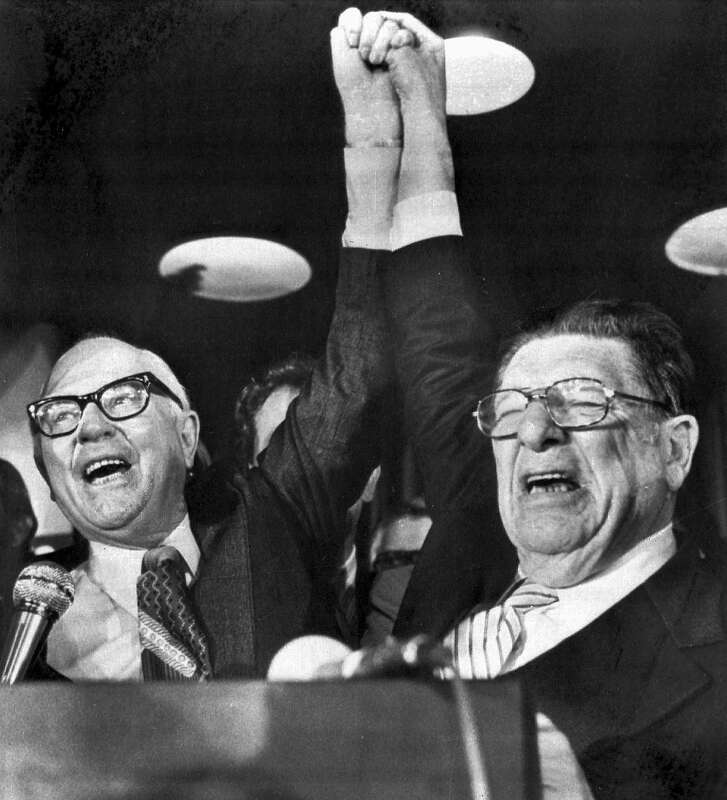 Paul Gann, left, and Howard Jarvis, hold up their hands on the night of June 7, 1978, as their co-authored initiative Proposition 13, took a commanding lead in the California primary. The Proposition provides monumental tax relief to property owners. Twenty-five years later, Prop. 13 has almost completely changed how California's governments get their revenue. (AP Photo/stf, File)