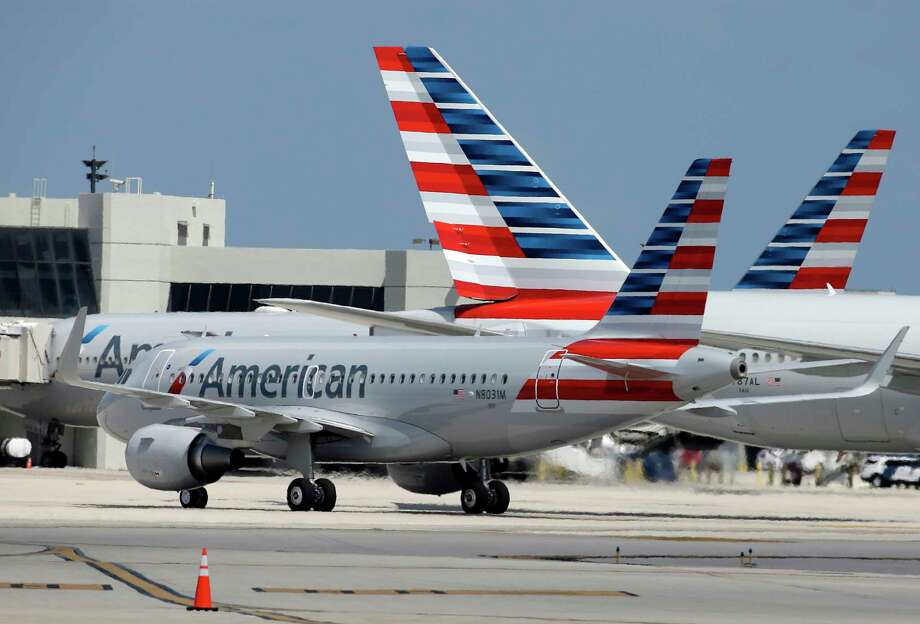An American Airlines jet taxis to the gate at Miami International Airport in this 2017 file photo. The pilot of one of the airline's Airbus jets reported a UFO encounter over Arizona in late February. Photo: Lynne Sladky, STF / Copyright 2017 The Associated Press. All rights reserved.