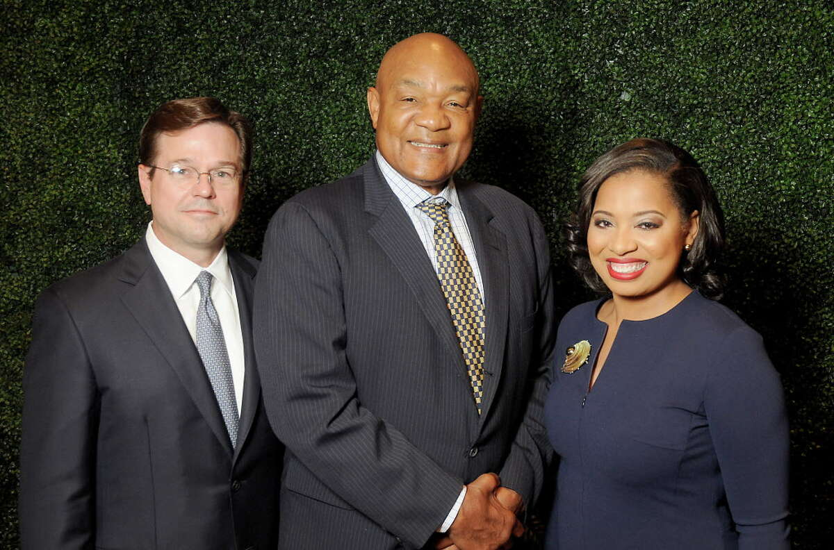 """Honoree George Foreman with chairs Champ Warren,at left, and Shawntell McWilliams at the Fifth Ward Enrichment Program's """"Changing Men, Changing Lives"""" luncheon at the Junior League of Houston honoring George Foreman Wednesday Oct. 25, 2017.(Dave Rossman Photo)"""