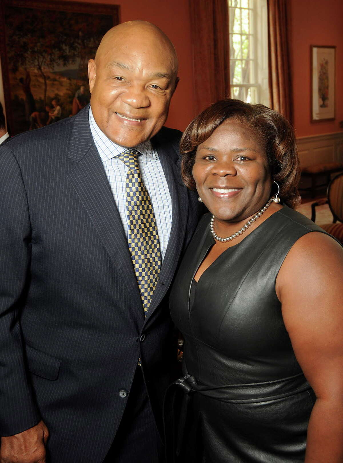 """Honoree George Foreman and Connie Whipple at the Fifth Ward Enrichment Program's """"Changing Men, Changing Lives"""" luncheon at the Junior League of Houston honoring George Foreman Wednesday Oct. 25, 2017.(Dave Rossman Photo)"""