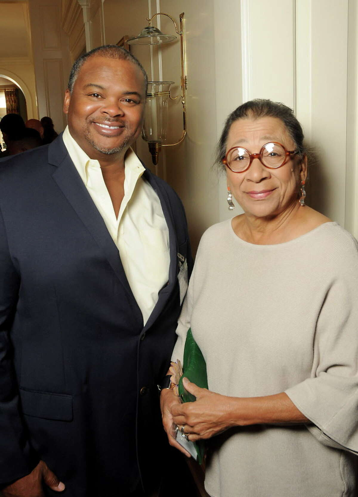 """Joe Carmouche and Erie Calloway at the Fifth Ward Enrichment Program's """"Changing Men, Changing Lives"""" luncheon at the Junior League of Houston honoring George Foreman Wednesday Oct. 25, 2017.(Dave Rossman Photo)"""