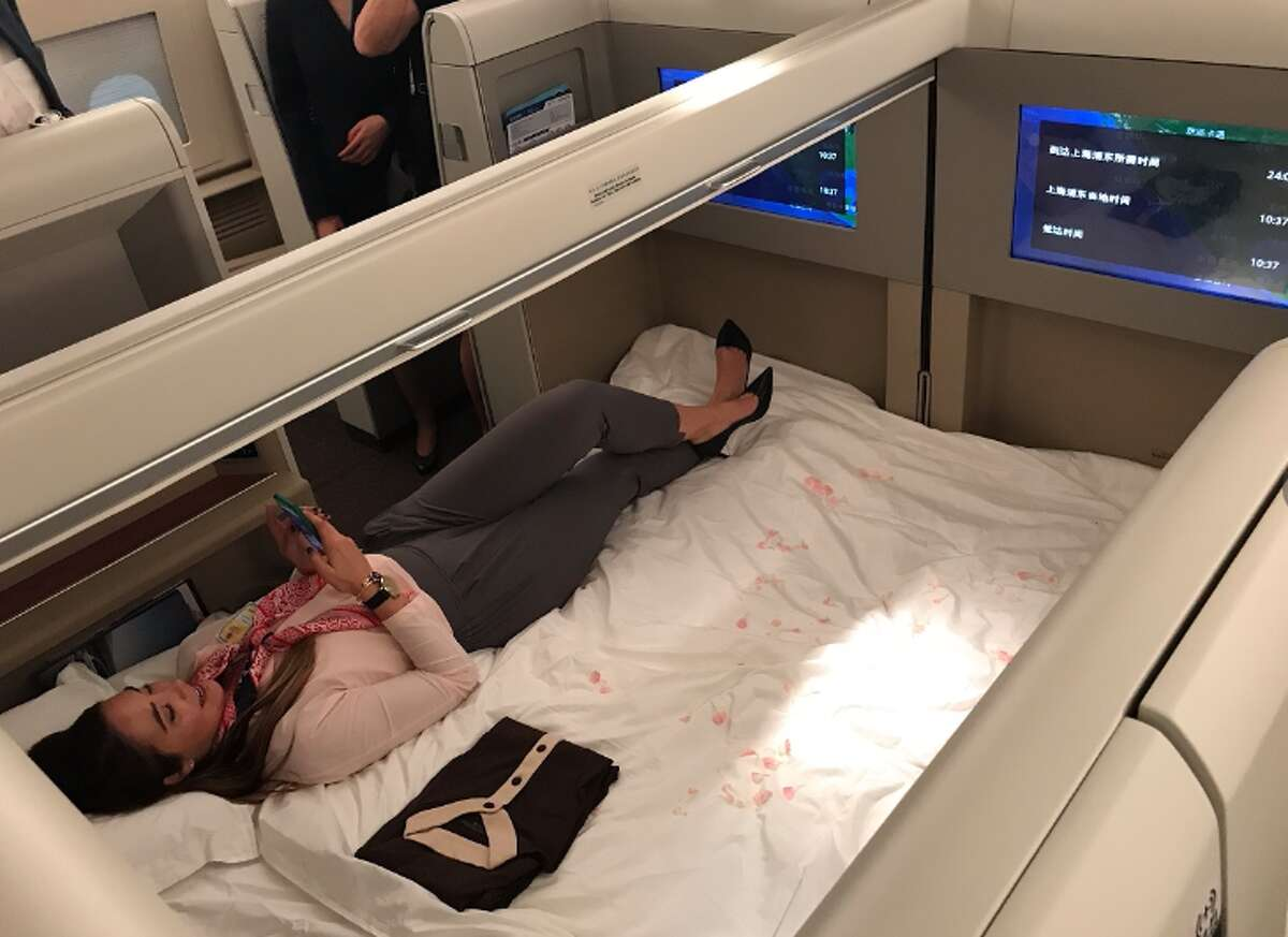 China Eastern's first class cabin offers a center cabin that folds down into a nice double bed (Photo: Chris McGinnis)