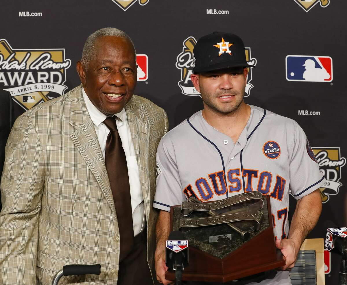 Houston Astros second baseman Jose Altuve (27) receives the Hank Aaron Award with Hank Aaron before Game 2 of the World Series at Dodger Stadium on Wednesday, Oct. 25, 2017, in Los Angeles. ( Brett Coomer / Houston Chronicle )