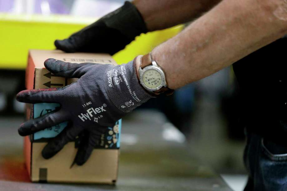 Amazon will launch a service next month that will let people allow their door to be unlocked when they're not there so packages can be left inside.  Photo: Julio Cortez, STF / Copyright 2017 The Associated Press. All rights reserved.