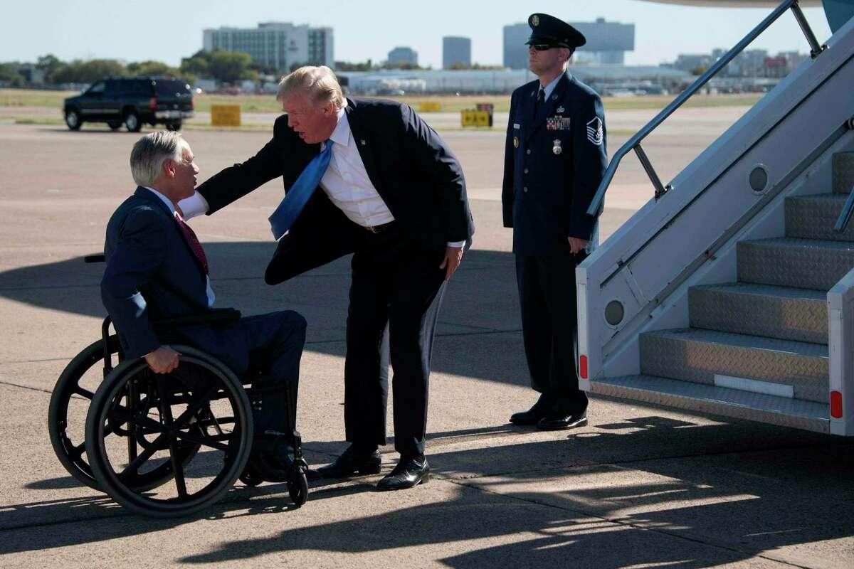 Gov. Greg Abbott greets President Trump at Dallas Love Field, October 25.