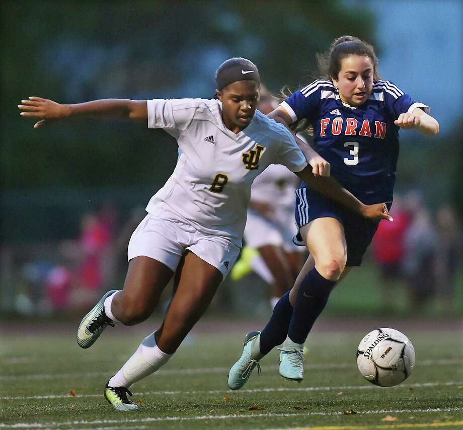 Foran junior defender Gabriella Muoio attacks Law junior forward Samara Thacker in a crosstown battle, Wednesday, Oct. 25, 2017, at Jonathan Law High School in Milford. Photo: Catherine Avalone, Hearst Connecticut Media / New Haven Register