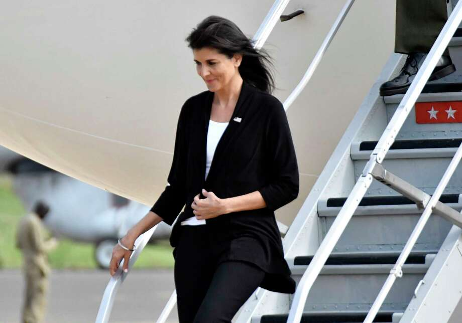 US Ambassador to the United Nations Nikki Haley arrives in Juba, South Sudan, Wednesday, Oct. 25, 2017. The U.S. ambassador to the United Nations, Nikki Haley, has been evacuated from a U.N. camp for displaced people in South Sudan because of a volatile demonstration against President Salva Kiir. An aid worker at the camp says U.N. security guards fired tear gas to disperse the crowd of more than 100 people shortly after Haley left. The ambassador, on a three-country Africa visit, met earlier with Kiir over the country's long civil war. (AP Photo) Photo: =, STR / Copyright 2017 The Associated Press. All rights reserved.