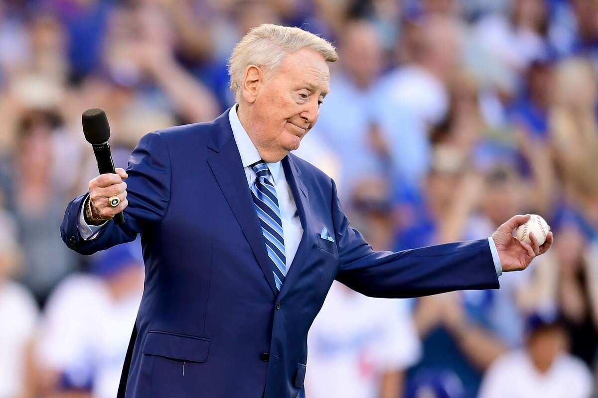 Former Los Angeles Dodgers broadcaster Vin Scully speaks to fans before game two of the 2017 World Series between the Houston Astros and the Los Angeles Dodgers at Dodger Stadium on October 25, 2017 in Los Angeles, California. (Photo by Harry How/Getty Images)