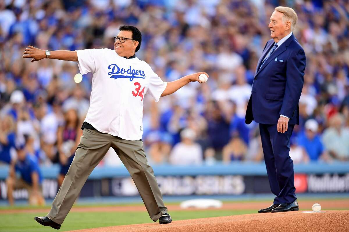 Former Los Angeles Dodgers player Fernando Valenzuela throws out the ceremonial first pitch as former Los Angeles Dodgers broadcaster Vin Scully looks on before game two of the 2017 World Series between the Houston Astros and the Los Angeles Dodgers at Dodger Stadium on October 25, 2017 in Los Angeles, California. (Photo by Harry How/Getty Images)