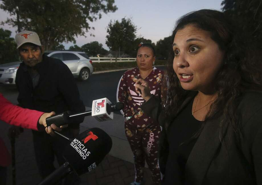 Leticia Gonzalez (right), a San Antonio attorney for 10-year-old Rosa Maria Hernandez, speaks Wednesday in front of the Baptist children's home in San Antonio. On the left is Hernandez's grandfather Jose Lugo and in the middle is the girl's cousin Aurora Cantu, an American citizen who lives in Mexico. Photo: John Davenport /San Antonio Express-News / ©John Davenport/San Antonio Express-News