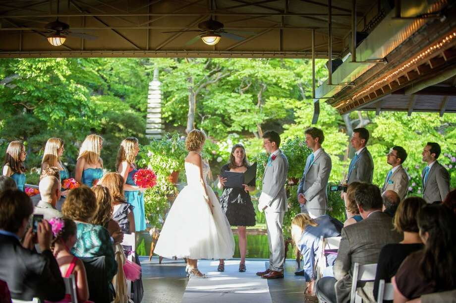 Lauren Van Mullem (left) and Charles Modica on their wedding day. Vow Muse co-founder Alicia Ostarello was their officiant. Photo: Flutter Glass Photography