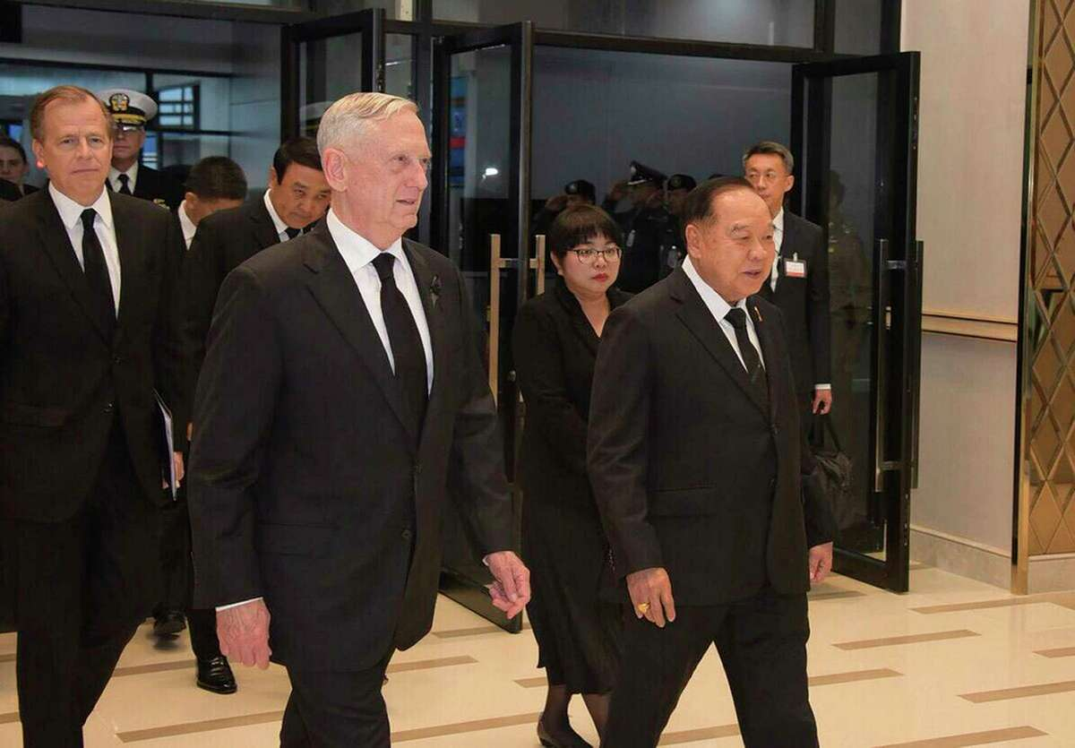 U.S. Defense Secretary Jim Mattis, second left, walks with Thai Minister of Defense Gen. Prawit Wongsuwan, as he arrives to attend the Royal Cremation Ceremony of late Thai King Bhumibol Adulyadej, in Bangkok, Thailand, Wednesday. Oct. 25, 2017. (Thailand Ministry of Foreign Affairs via AP)