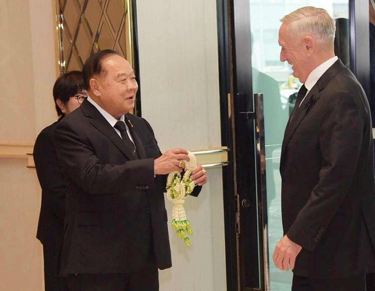 U.S. Defense Secretary Jim Mattis, right, is greeted by Thai Minister of Defense Gen. Prawit Wongsuwan, as he arrives to attend the Royal Cremation Ceremony of late Thai King Bhumibol Adulyadej, in Bangkok, Thailand, Wednesday, Oct. 25, 2017. (Thailand Ministry of Foreign Affairs via AP)