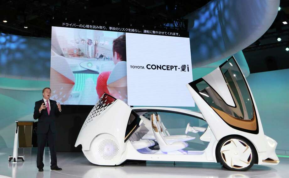 Didier Leroy, executive vice president of Toyota Motor Corp., presents a Toyota Concept-i concept car during the media preview of the Tokyo Motor Show in Tokyo Wednesday, Oct. 25, 2017. (AP Photo/Eugene Hoshiko) Photo: Eugene Hoshiko, STF / Copyright 2017 The Associated Press. All rights reserved.