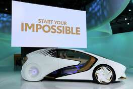 A Toyota Concept-i concept car is displayed during the media preview of the Tokyo Motor Show in Tokyo Wednesday, Oct. 25, 2017. (AP Photo/Eugene Hoshiko)