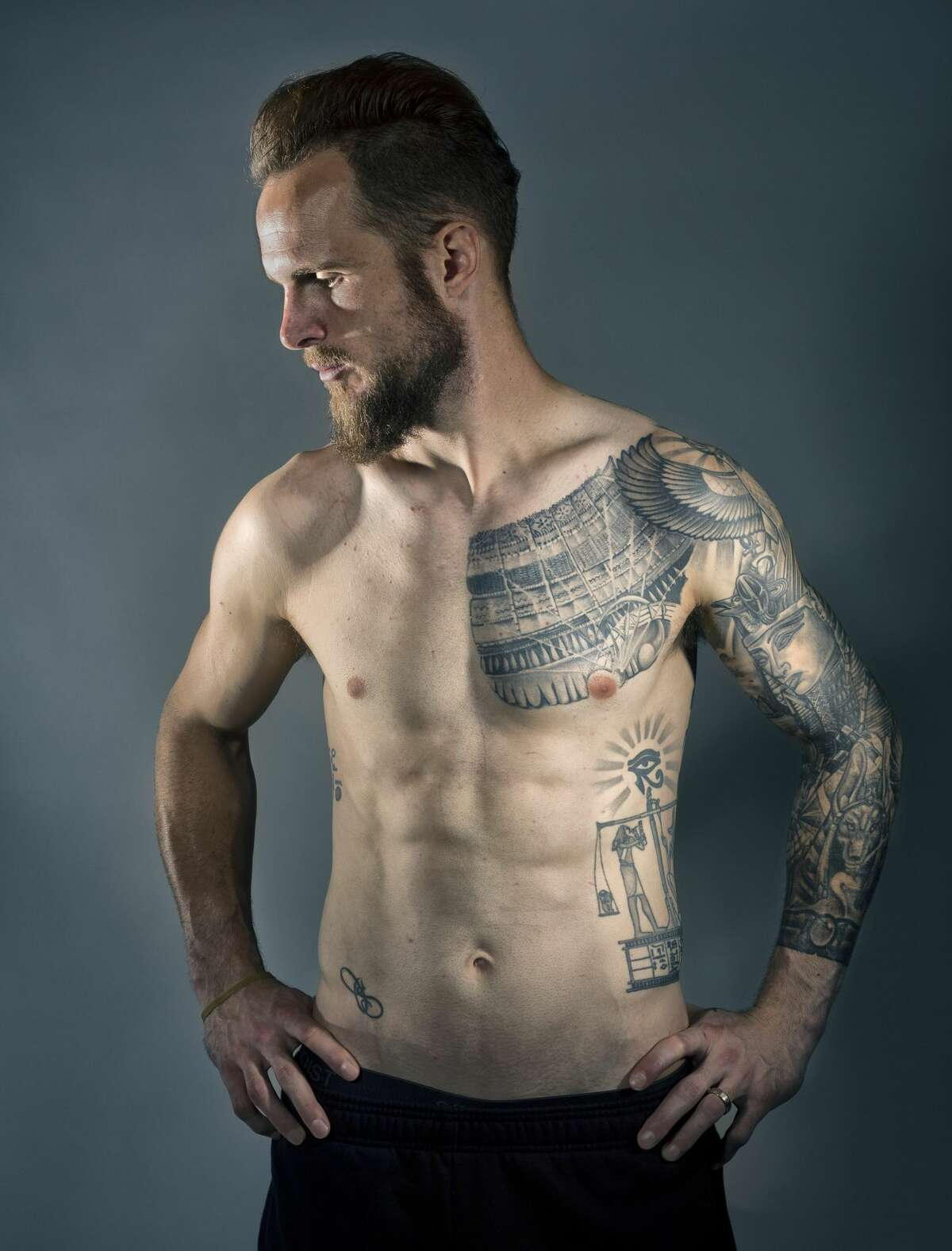 """""""Most of the artsy ones are all Egyptian themed. I studied classical civilization when I was in college, so I have always been fascinated by Egyptian stuff."""" said Stefan Frei about his tattoos. Frei has been the goal keeper for the Sounders since 2014. He has a full sleeve and back piece, as well as his and his wife's initials and a quote from the Book of the Dead that reads """"pay attention to what you do in life because all your actions will be weighed in the end."""" (Genna Martin, seattlepi.com)"""