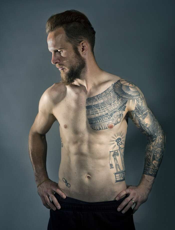 """Most of the artsy ones are all Egyptian themed. I studied classical civilization when I was in college, so I have always been fascinated by Egyptian stuff."" said Stefan Frei about his tattoos. Frei has been the goal keeper for the Sounders since 2014. He has a full sleeve and back piece, as well as his and his wife's initials and a quote from the Book of the Dead that reads ""pay attention to what you do in life because all your actions will be weighed in the end.""     (Genna Martin, seattlepi.com) Photo: GENNA MARTIN, SEATTLEPI"