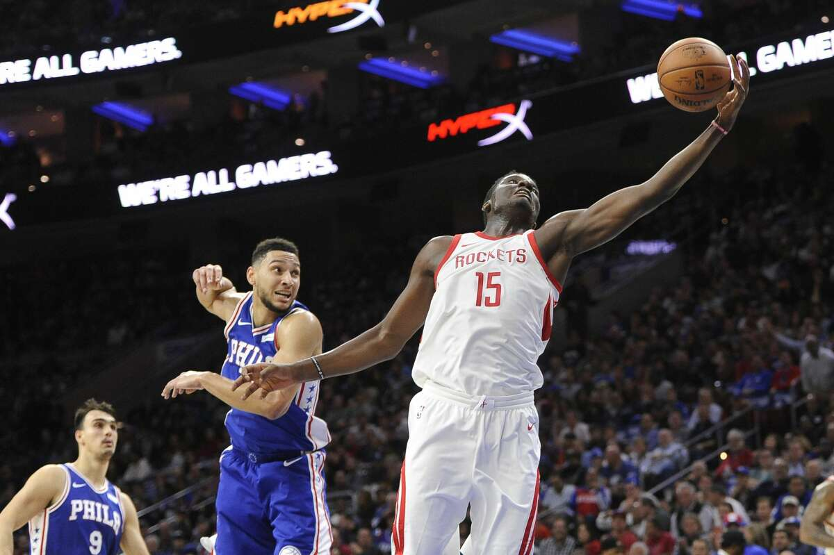 Houston Rockets' Clint Capela (15) reaches for the ball as Philadelphia 76ers' Ben Simmons defends the first half of an NBA basketball game, Wednesday, Oct. 25, 2017, in Philadelphia. The Rockets won 105-104. (AP Photo/Michael Perez)