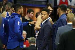 The Philadelphia 76ers' Markelle Fultz, middle, did not dress for the game against the Houston Rockets at the Wells Fargo Center in Philadelphia on Wednesday, Oct. 25, 2017. (Charles Fox/Philadelphia Inquirer/TNS)