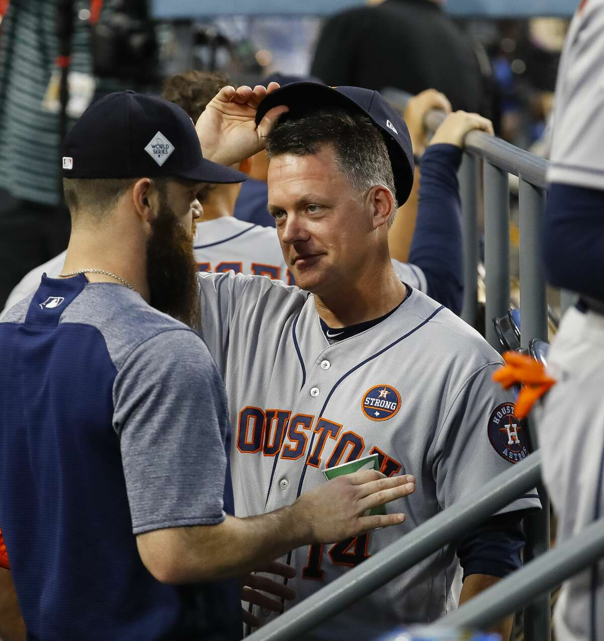 A.J. Hinch talks with Dallas Keuchel during Game 2 of the World Series at Dodger Stadium on Wednesday, Oct. 25, 2017, in Los Angeles.