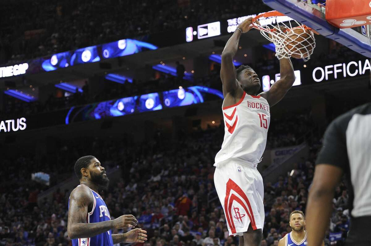 Houston Rockets' Clint Capela (15) dunks the ball over Philadelphia 76ers' Amir Johnson in the first half of an NBA basketball game, Wednesday, Oct. 25, 2017, in Philadelphia. (AP Photo/Michael Perez)