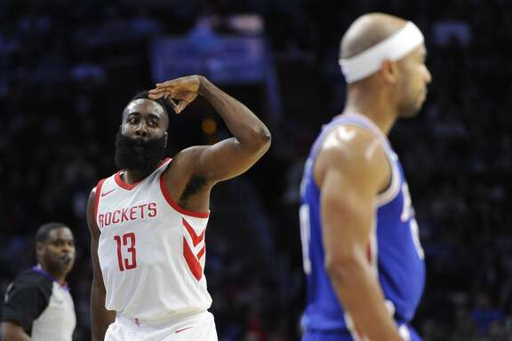 Houston Rockets' James Harden (13) gestures near Philadelphia 76ers' Jerryd Bayless after scoring a basket in the first half of an NBA basketball game, Wednesday, Oct. 25, 2017, in Philadelphia. The Rockets won 105-104. (AP Photo/Michael Perez)