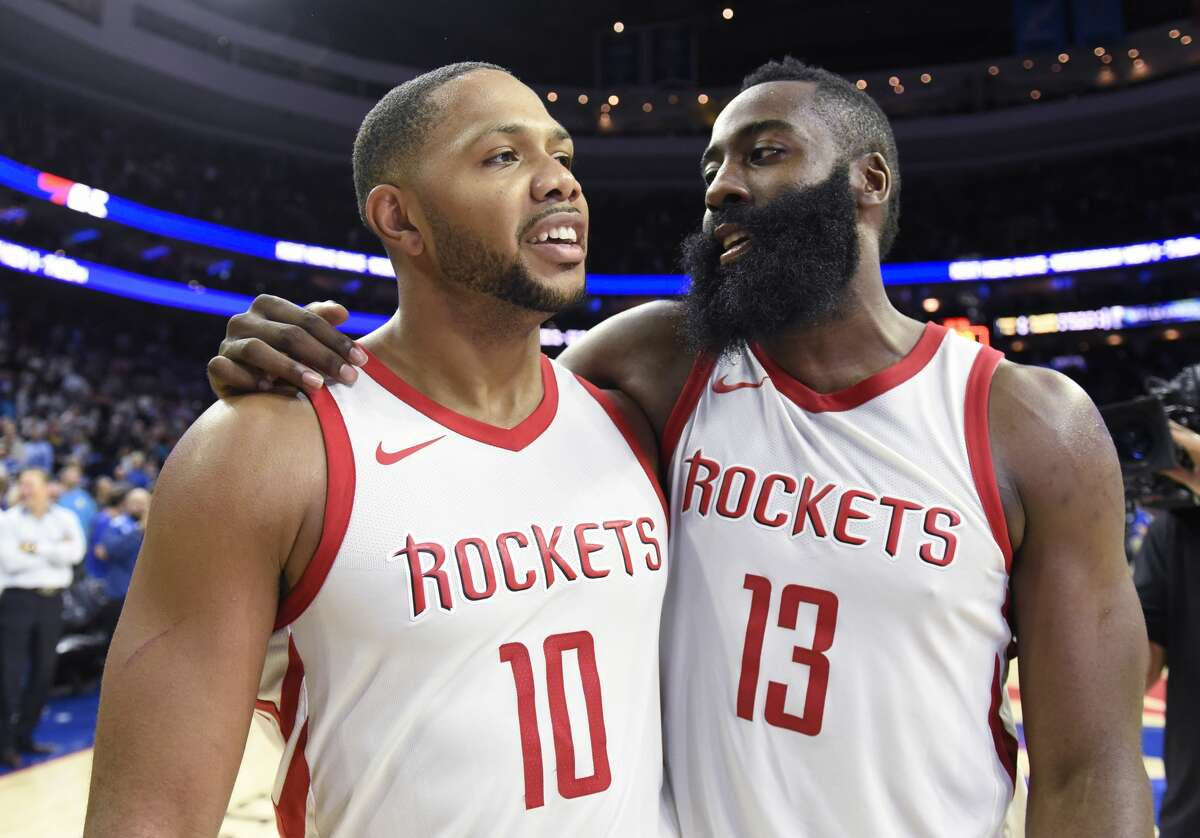 Houston Rockets' Eric Gordon, left, celebrates with James Harden at the end of the second half of an NBA basketball game against the Philadelphia 76ers, Wednesday, Oct. 25, 2017, in Philadelphia. The Rockets won 105-104. (AP Photo/Michael Perez)