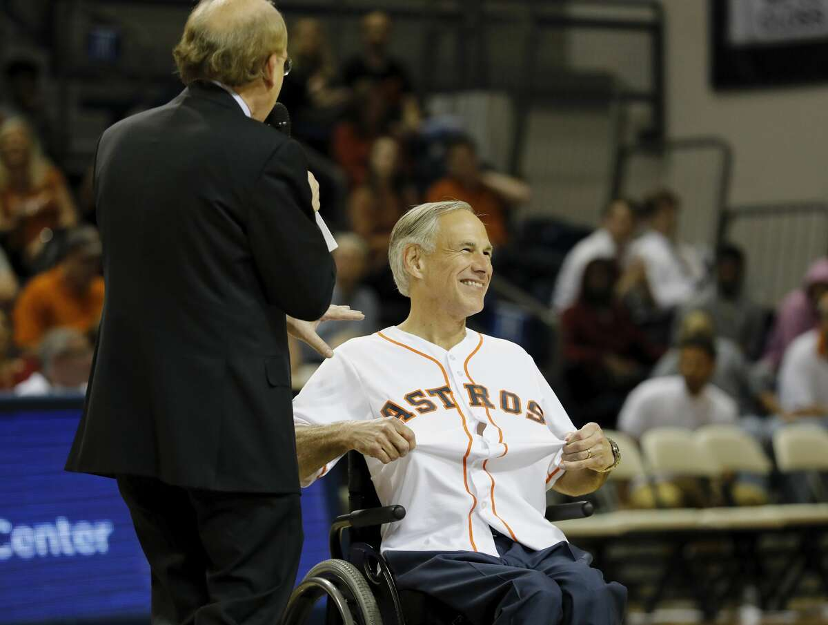 Texas Governor Greg Abbott wears a Houston Astros jersey during the exhibition basketball game between the Texas Longhorns and the Texas A&M Aggies to benefit the Rebuild Texas Relief Fund at Tudor Fieldhouse in Houston, TX on Wednesday, October 25, 2017.