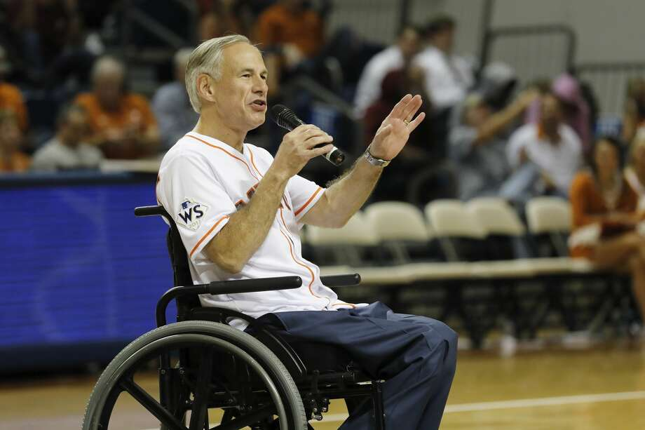 Texas Governor Greg Abbott speaks to the crowd at halftime during the exhibition basketball game between the Texas Longhorns and the Texas A&M Aggies to benefit the Rebuild Texas Relief Fund at Tudor Fieldhouse in Houston, TX on Wednesday, October 25, 2017. Photo: Tim Warner/For The Chronicle