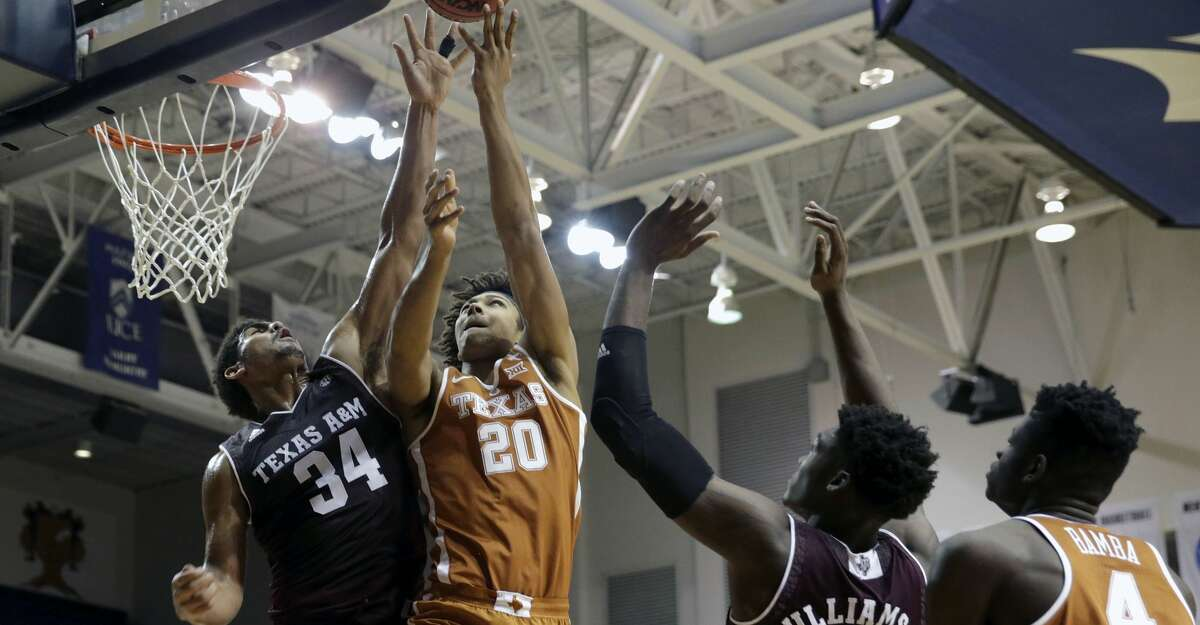 Texas forward Jericho Sims (20) goes up for a layup defended by Texas A&M center Tyler Davis (34) during the first half of an NCAA exhibition basketball game, Wednesday, Oct. 25, 2017 in Houston. (Tim Warner/Houston Chronicle via AP)