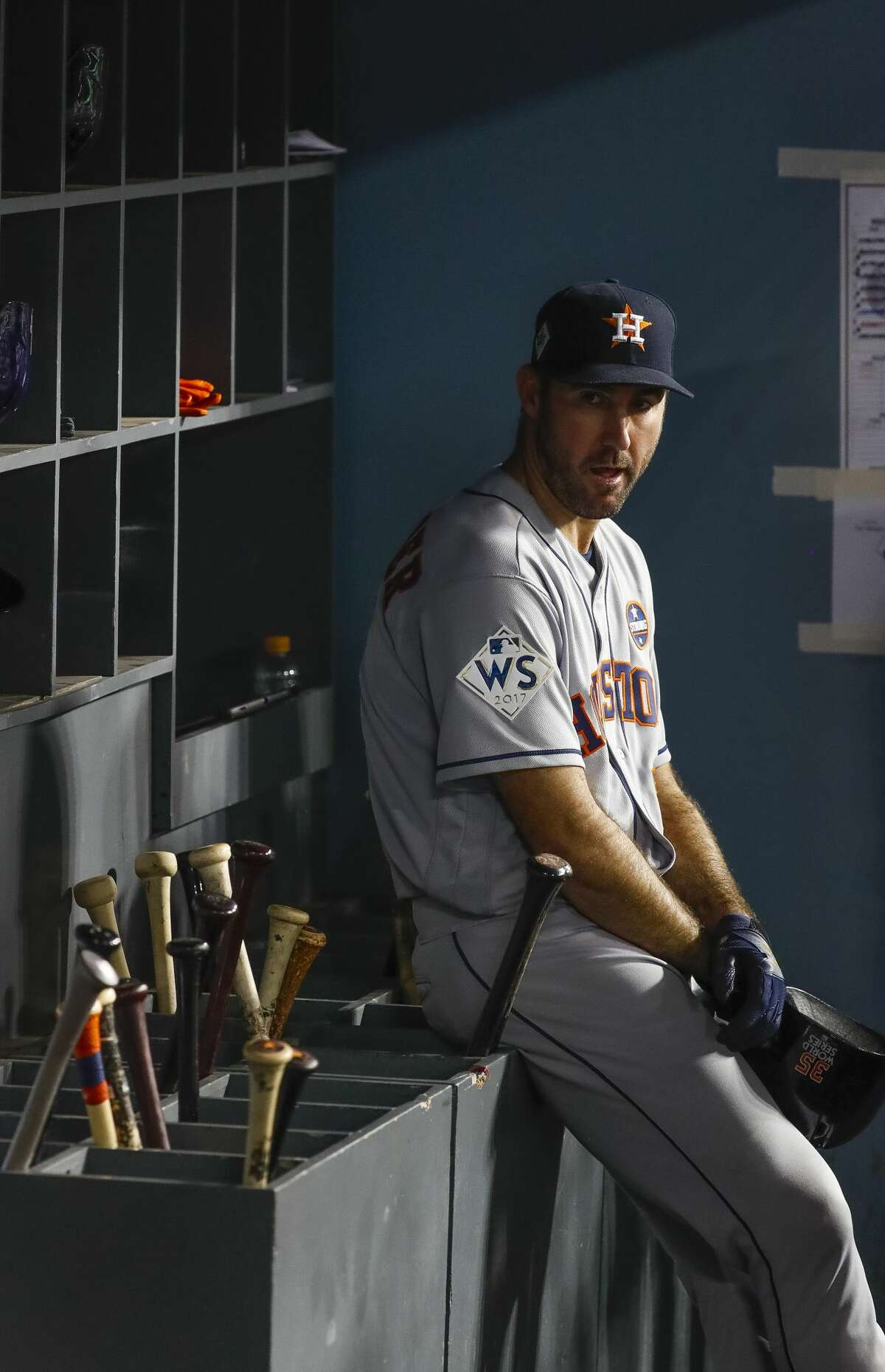 Houston Astros starting pitcher Justin Verlander (35) sits in the dugout after being pulled from Game 2 of the World Series at Dodger Stadium on Wednesday, Oct. 25, 2017, in Los Angeles.