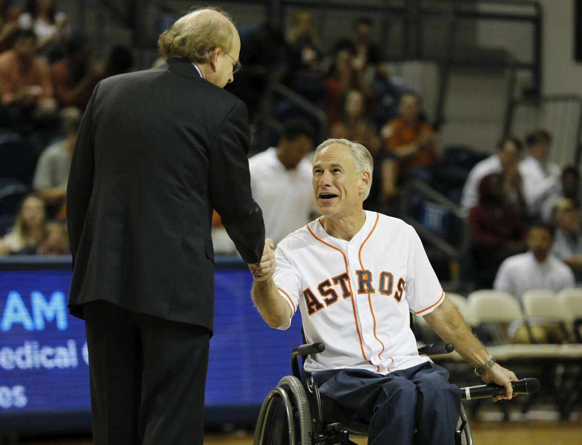 Rice University President David Leebron shakes hands with Texas Governor Greg Abbott at halftime during the exhibition basketball game between the Texas Longhorns and the Texas A&M Aggies to benefit the Rebuild Texas Relief Fund at Tudor Fieldhouse in Houston, TX on Wednesday, October 25, 2017.