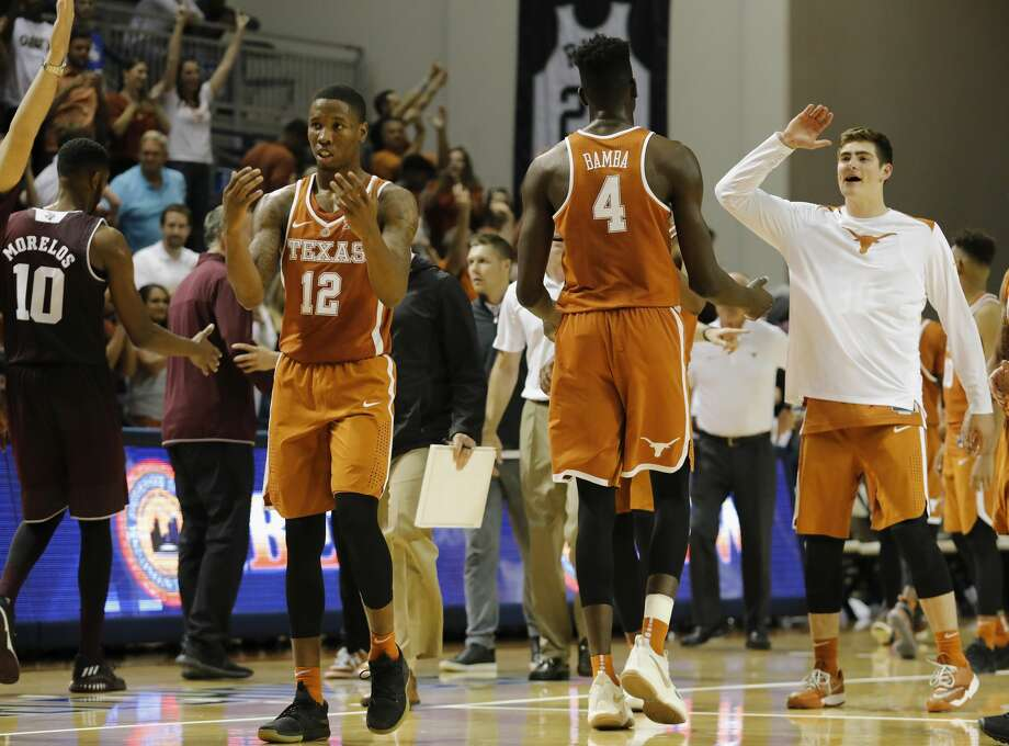 Texas Longhorns forward Mohamed Bamba (4) and guard Kerwin Roach II (12) celebrate after the exhibition basketball game between the Texas Longhorns and the Texas A&M Aggies to benefit the Rebuild Texas Relief Fund at Tudor Fieldhouse in Houston, TX on Wednesday, October 25, 2017. Photo: Tim Warner/For The Chronicle