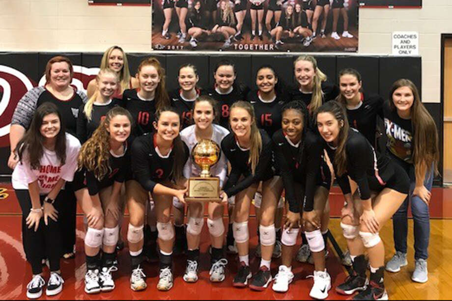The Langham Creek High School volleyball team celebrates its District 17-6A championship and No. 1 seed going into the postseason. The Lobos will face Houston Carnegie at 5 p.m. on Oct. 30 at Houston ISD's Delmar Fieldhouse. Photo: Cy-Fair ISD