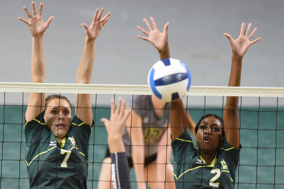 Midland College's Kristen Johnson (7) and Taylor Smith (2) block against New Mexico Military Institute on Oct. 25, 2017 at Chaparral Center. James Durbin/Reporter-Telegram Photo: James Durbin