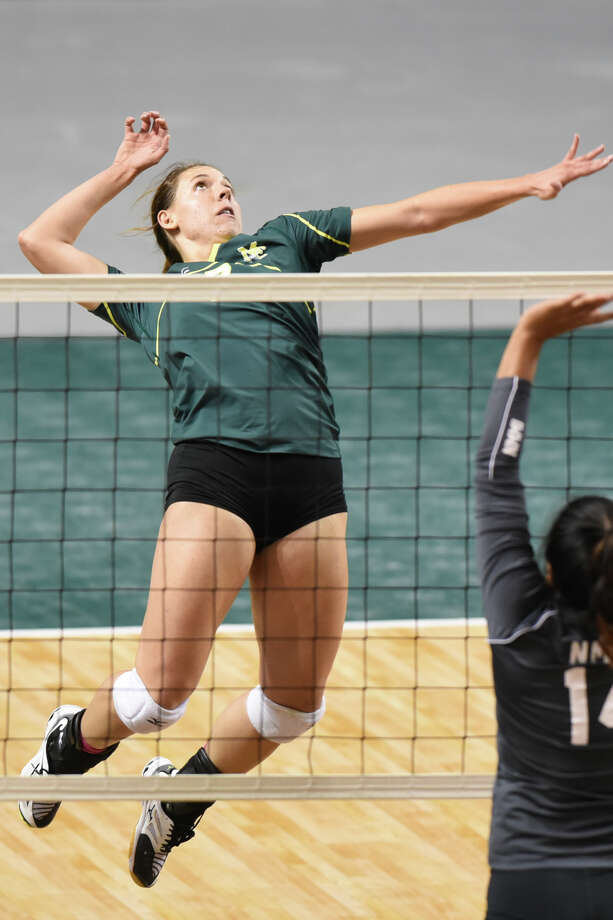 Midland College's Kristen Johnson (7) jumps up for a hit against New Mexico Military Institute on Oct. 25, 2017 at Chaparral Center. James Durbin/Reporter-Telegram Photo: James Durbin