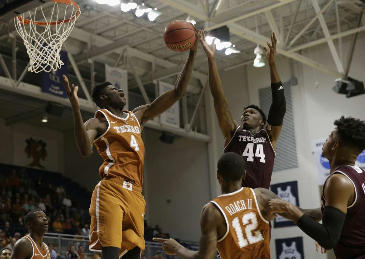 Texas forward Mohamed Bamba (4) grabs a rebound from Texas A&M forward Robert Williams (44) in the second half of a college basketball exhibition game in Houston, Texas, Wednesday, Oct. 25, 2017. The game was to benefit the Rebuild Texas Relief Fund. (Tim Warner/Houston Chronicle via AP)