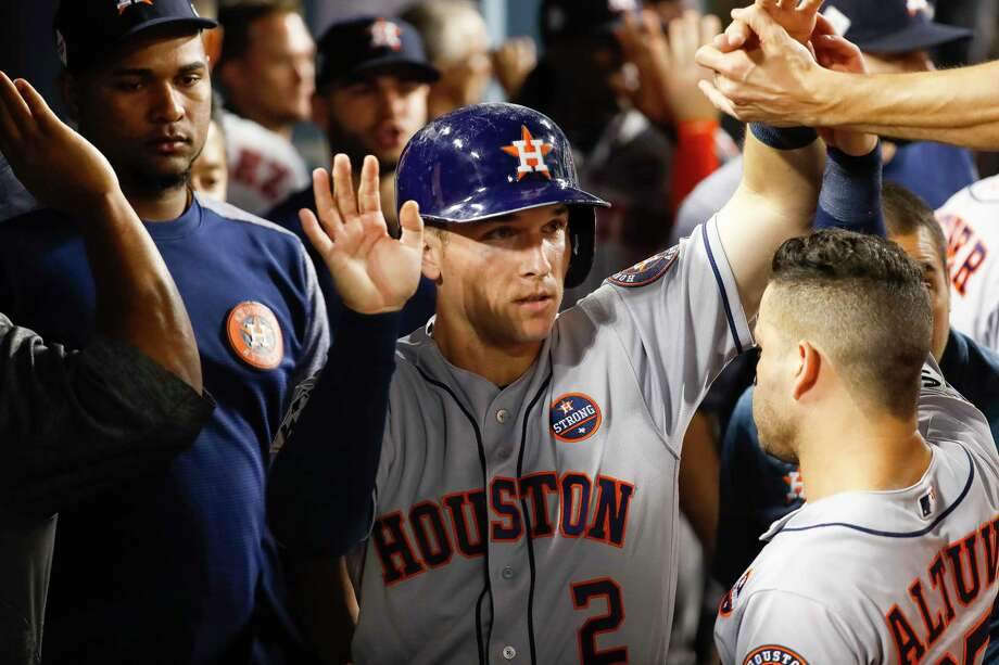 Houston Astros third baseman Alex Bregman (2) celebrates in the dugout after scoring on a Carlos Correa single during the eighth inning of Game 2 of the World Series at Dodger Stadium on Wednesday, Oct. 25, 2017, in Los Angeles.  PHOTOS: For a look at the Astros' performances in the Home Run Derby, browse through the slideshow. Photo: Karen Warren, Houston Chronicle / © 2017 Houston Chronicle