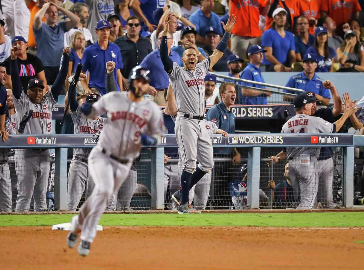 Houston Astros shortstop Carlos Correa (1) celebrates Houston Astros left fielder Marwin Gonzalez's (9) home run during the ninth inning of Game 2 of the World Series at Dodger Stadium on Wednesday, Oct. 25, 2017, in Los Angeles.
