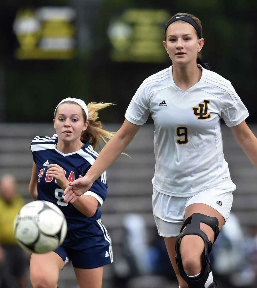 Law senior captain Madison Butts battles Foran senior forward Emily Kwalek for a loose ball, Wednesday, Oct. 25, 2017, at Lawmen Stadium at Jonathan Law High School in Milford.  The game ended in a 2-2 tie. Photo: Catherine Avalone, Hearst Connecticut Media / New Haven Register