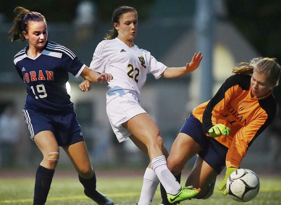 Law junior Jocelyn Wirth battles Foran juniors Sara Portoff and goalkeeper Abigail Lucas, Wednesday, Oct. 25, 2017, at Lawmen Stadium at Jonathan Law High School in Milford. The game ended in a 2-2 tie. Photo: Catherine Avalone, Hearst Connecticut Media / New Haven Register