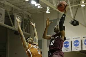 Texas A&M Aggies guard Jay Jay Chandler (0) goes up for a shot defended by Texas Longhorns guard Jacob Young (3) in the second half during the exhibition basketball game between the Texas Longhorns and the Texas A&M Aggies to benefit the Rebuild Texas Relief Fund at Tudor Fieldhouse in Houston, TX on Wednesday, October 25, 2017.