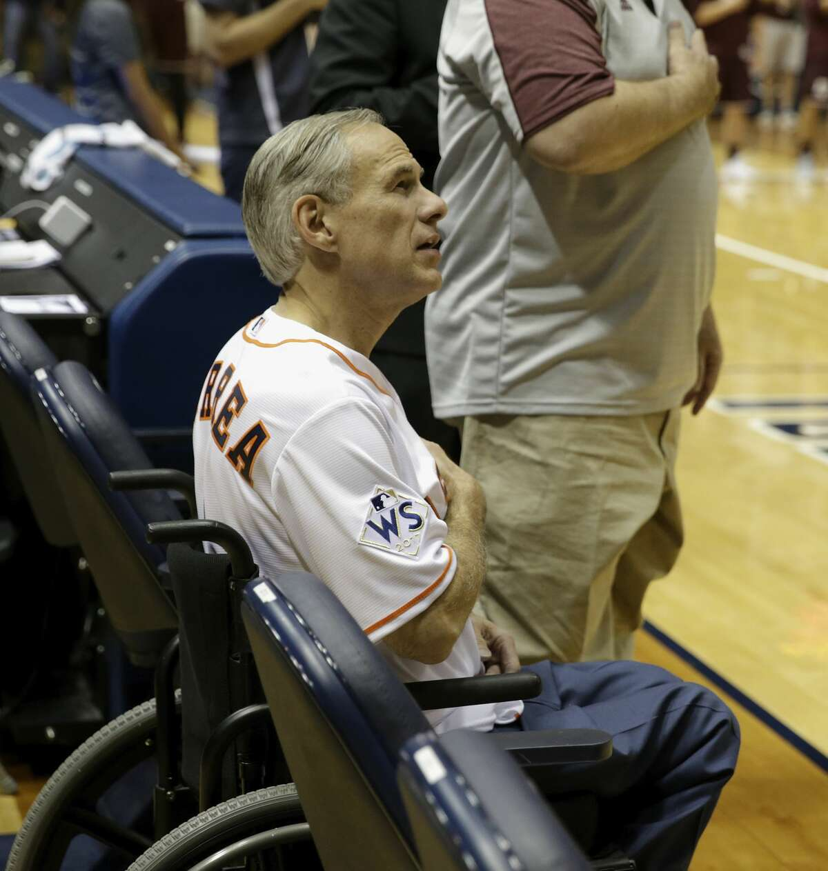 Texas Governor Greg Abbott sings during the National Anthem during the exhibition basketball game between the Texas Longhorns and the Texas A&M Aggies to benefit the Rebuild Texas Relief Fund at Tudor Fieldhouse in Houston, TX on Wednesday, October 25, 2017.