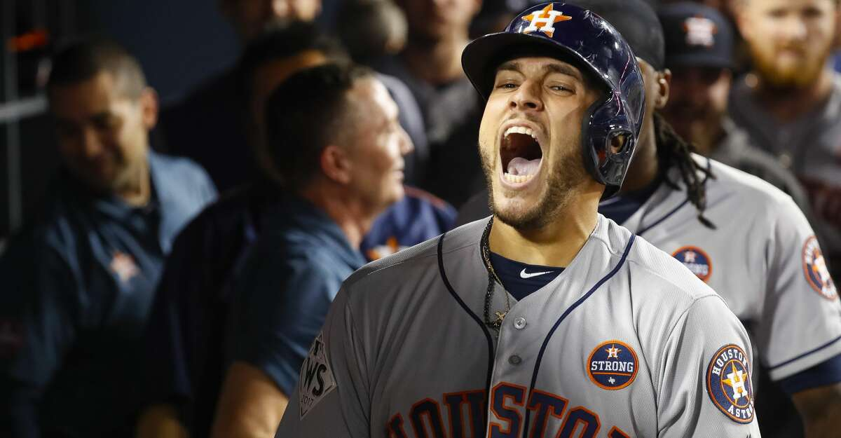 Houston Astros center fielder George Springer (4) reacts after hitting a two-run home run in the eleventh inning of Game 2 of the World Series at Dodger Stadium on Wednesday, Oct. 25, 2017, in Los Angeles. ( Karen Warren / Houston Chronicle )