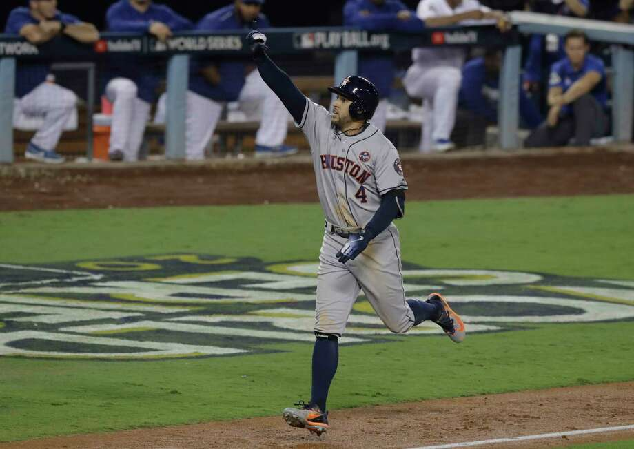 Houston Astros' George Springer celebrates after hitting a two-run home run during the 11th inning of Game 2 of baseball's World Series against the Los Angeles Dodgers Wednesday, Oct. 25, 2017, in Los Angeles. (AP Photo/Alex Gallardo) Photo: Alex Gallardo, FRE / Solar_Eclipse