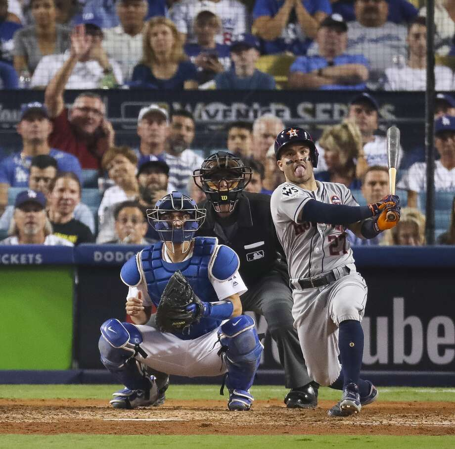 Houston Astros second baseman Jose Altuve (27) hits a home run in the tenth inning of Game 2 of the World Series at Dodger Stadium on Wednesday, Oct. 25, 2017, in Los Angeles. Photo: Michael Ciaglo/Houston Chronicle